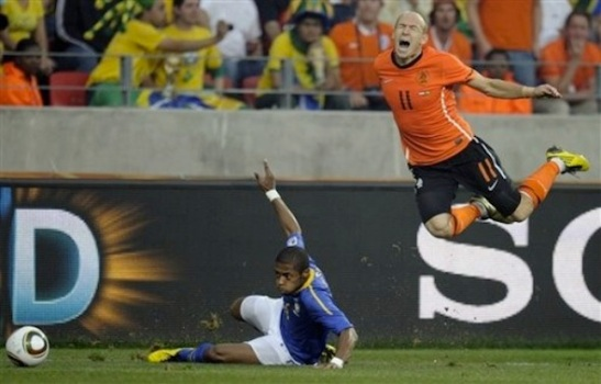 Netherlands' Arjen Robben, right, reacts after being tackled by Brazil's Michel Bastos, left, during the World Cup quarterfinal soccer match between the Netherlands and Brazil at Nelson Mandela Bay Stadium in Port Elizabeth, South Africa, Friday, July 2, 2010. (AP Photo/Martin Meissner)